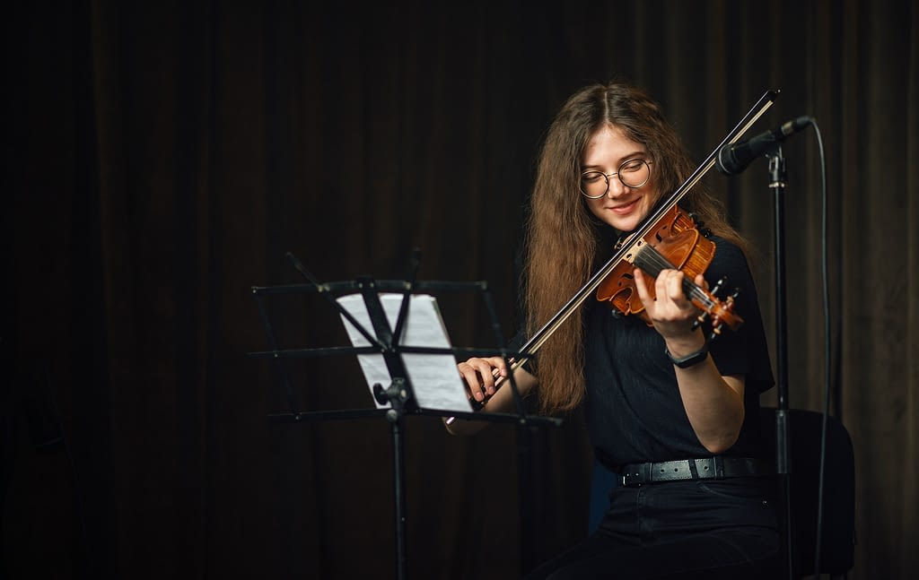 Classical musician playing the violin on stage