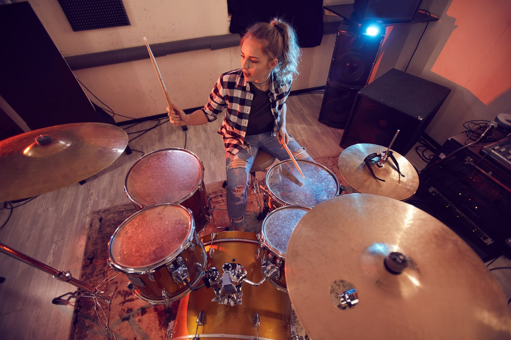 Young Woman Rocking Drums