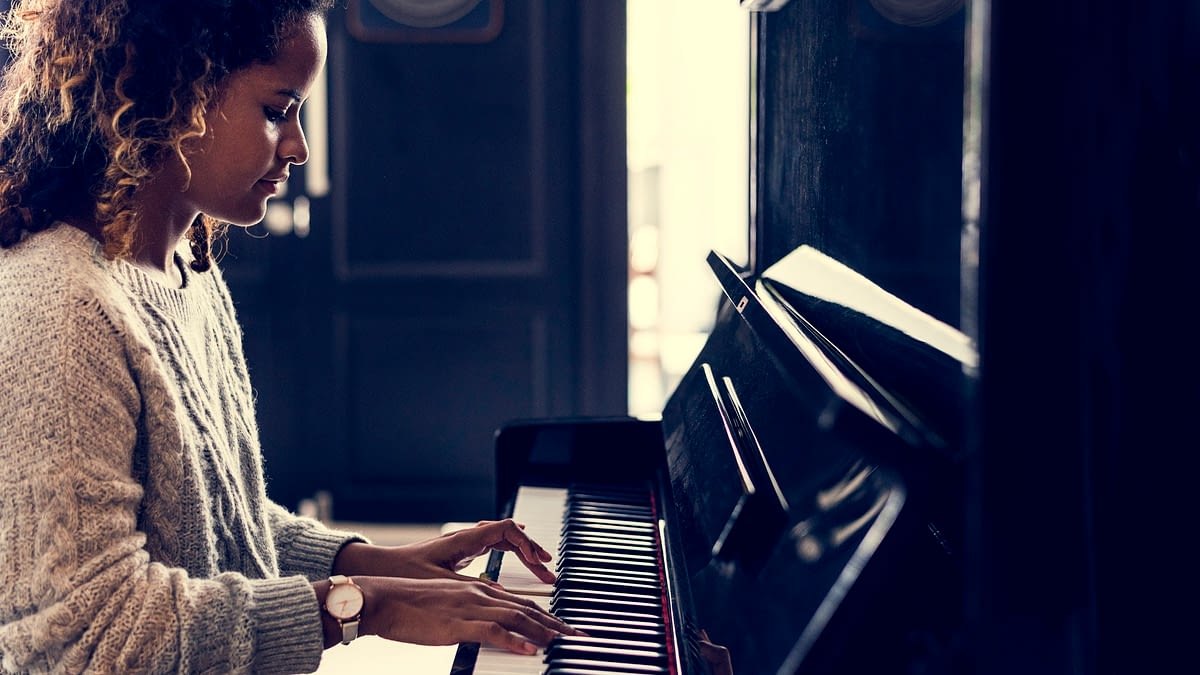 Woman playing on a piano
